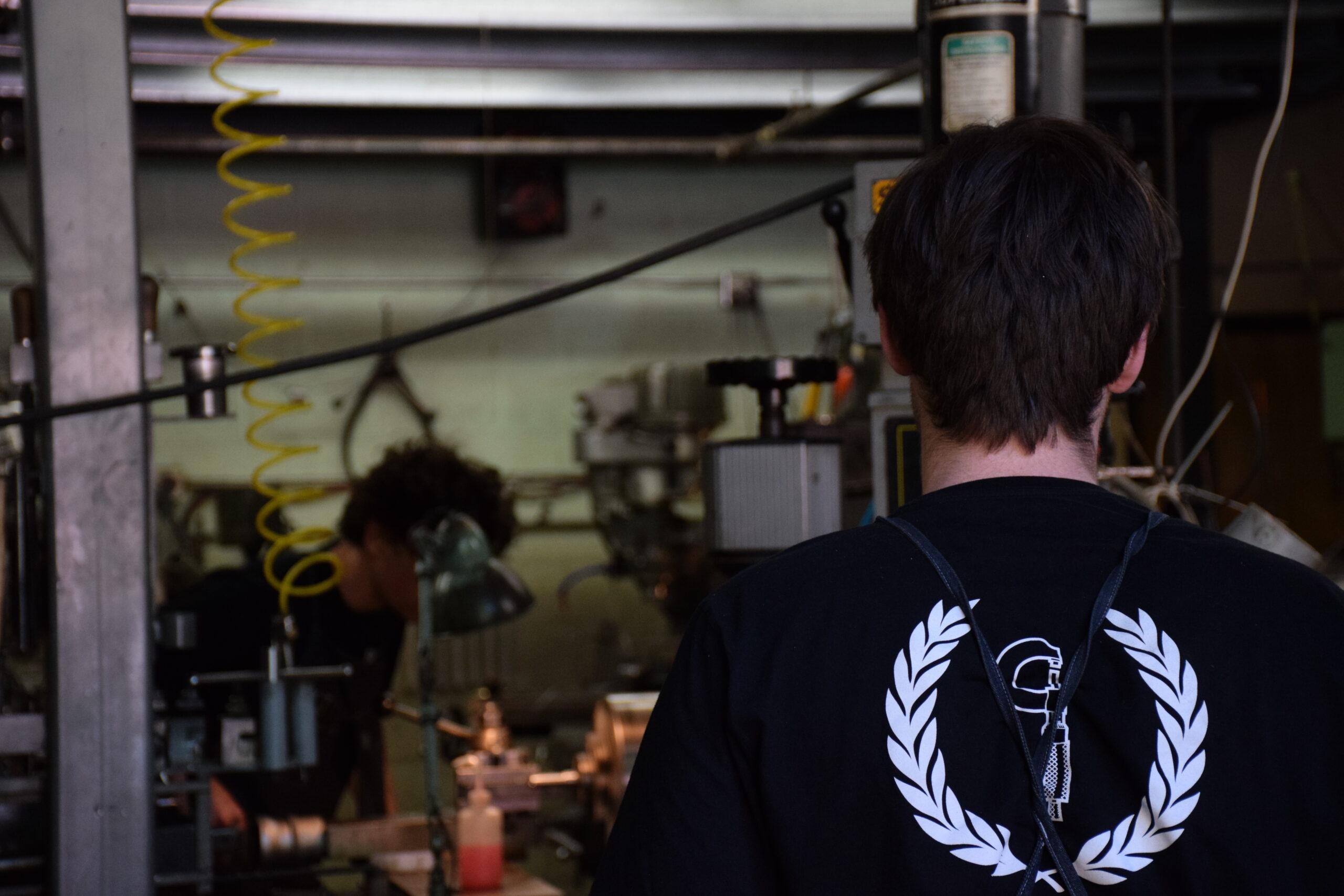 Logan viewing manual machinist using lathe