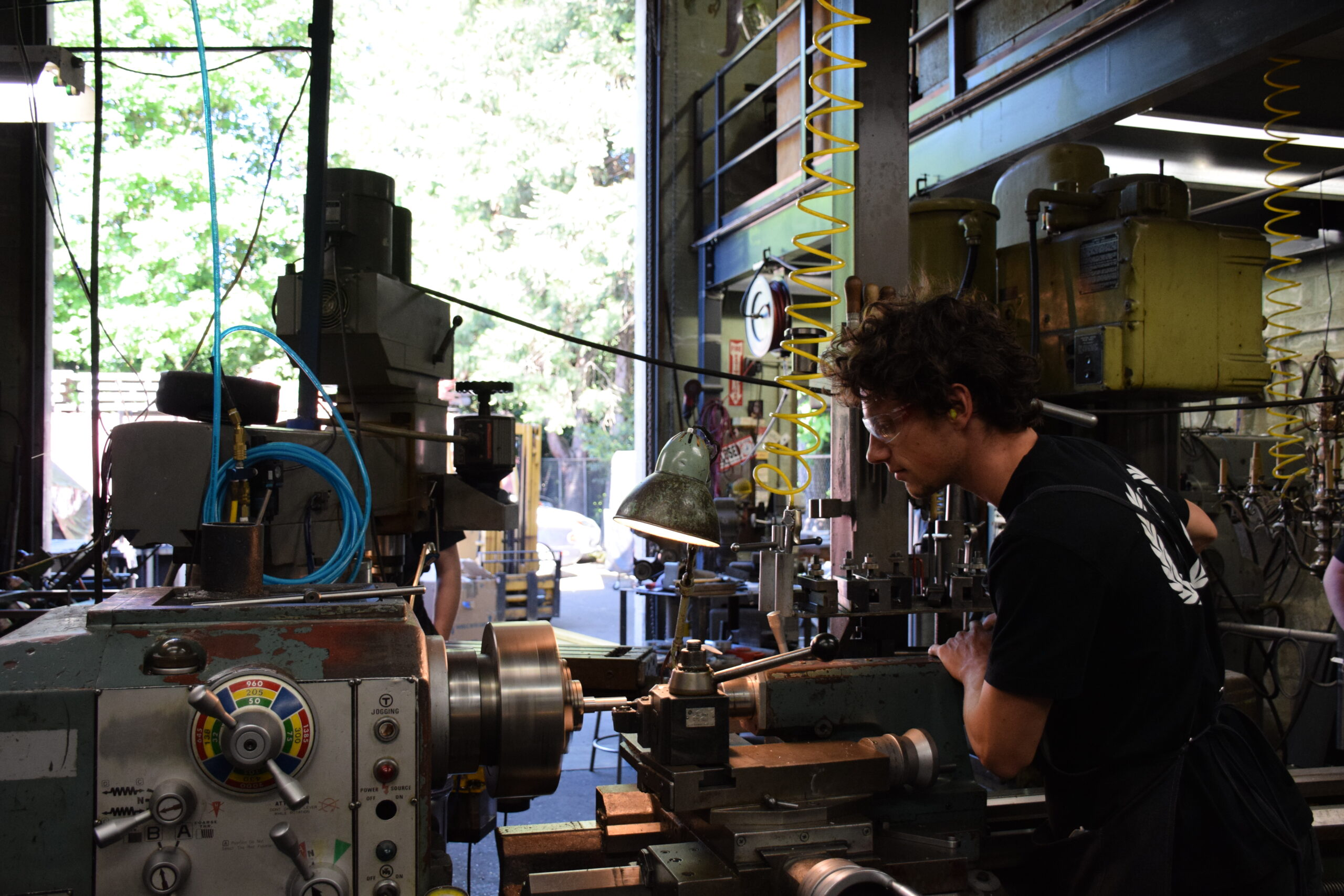 Proffesional machinist working on a lathe